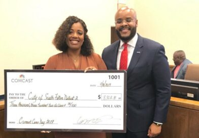 Comcast Awards Grant, Laptops at City Council Meeting
